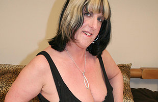 Big titted mature slut carryingon here herself