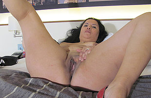 Kinky mature slut playing on her bed on every side a dildo
