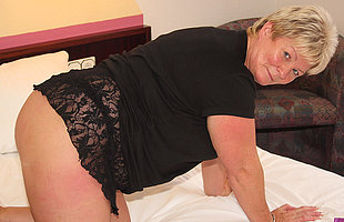 Chubby mature slut playing near her toys