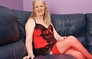 Horny mature slut masturbaying on the couch