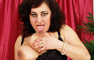 Horny big titted mature slattern playing with themselves