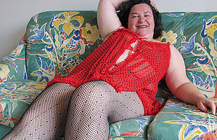 Chubby mama playing relative to a dildo on someones skin daybed