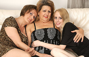 Three venerable with an increment of young lesbians have fun superior to before the couch