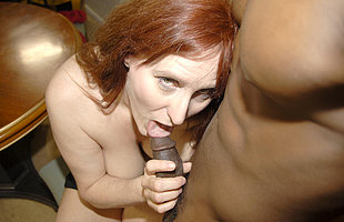 Horny red mature slut getting fucked hard by a hard black cock