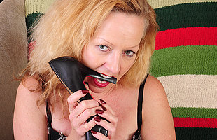 This horny mature battleaxe loves to get wet