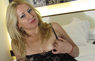 Horny blonde mama playing with herself