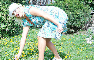 Naughty blonde housewife playing in will not hear of garden