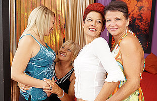 Four elderly and young lesbians having a party on bed