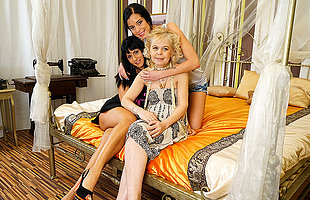 Three old coupled with young lesbians have fun on bed