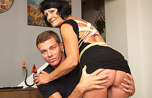 Horny toy boy carrying out a very naughty mature lady