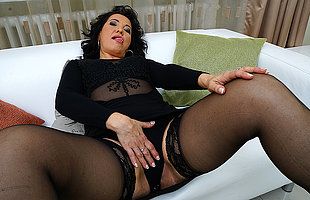 Horny mature slut playing on the settee