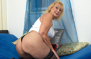 Horny mature lady carryingon with her shaved pussy