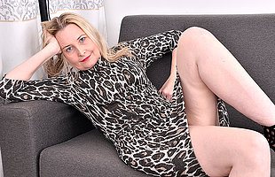 Horny British housewife object wet and aside on her couch