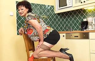 naughty fat mature lady getting untidy in her kitchen