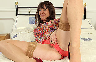 Hairy British housewife playing concerning the brush pussy