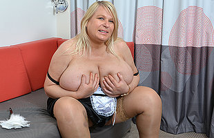 Huge breasted British lady getting soiled on her couch