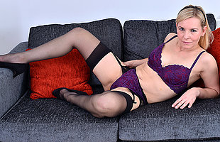 Naughty blonde housewife playing with their way pussy