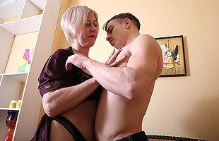 Horny of age lady having fun with her toy boy