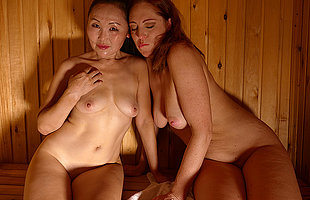 Two mature lesbians fisting in the sauna