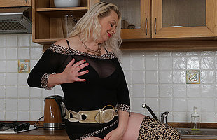 Busty blonde Milf sticks her toy deep into her pussy
