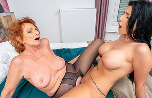 Grandma and busty young girl lick each others pussies