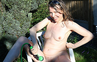 Naughty housewife gets naked outdoors and gets her hairy pussy all wet