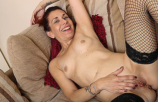 British housewife undresses and plays connected with her shaved pussy