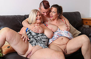 Two busty British housewives share their toyboys cock in hot threesome