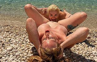 Horny British Milf and her young fixture enjoy each others pussies on someones skin beach