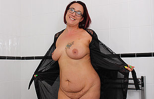 British housewife playing roughly will not hear of shaved pussy in the bathtub