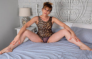 Sexy Milf strips off her clothes and works her shaved pussy